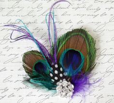 I love this! It would look pretty in your hair by itself or as a pin with the vail...Just an idea :)
