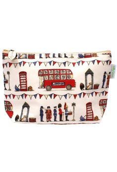 """Your essential daily stuff fits handily in this durable  cotton makeup bag, decorated with playful London pageantry.  Its water-resistant, wipe-clean coating and secure magnetic  closure keep everything nice and dry inside. Zippered, fully  lined and divided  into two open pockets for at-a-glance organizing. Laminated  100% cotton, 8 3/4""""w x 5 1/4""""h x 2 1/2""""d."""