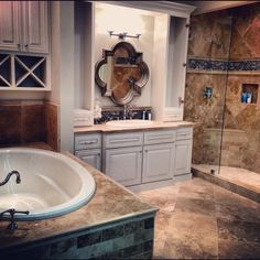 The luxurious travertine master bath #thetileshop