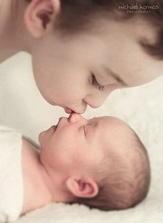 .how cute! If I could get Brayden to actually kiss his future brother or sister on the nose like that one day!