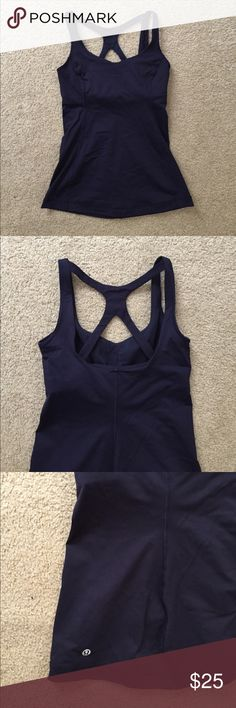 Navy Lululemon Tank Top Navy Lululemon tank top with fun pattern in back. Built in sports bra with no pads. In like new condition. I love it, but I'm typically a 4/6 in lulu tops, and it's a little too tight through the chest for me. lululemon athletica Tops Tank Tops