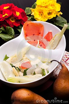 New stock photo at Dreamstime: Bowl with salad of fennel, pears and white cheese together with smoked salmon.