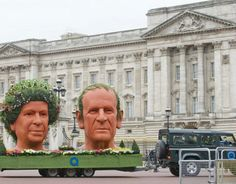 Giant terracotta versions of the Queen and Duke of Edinburgh's heads outside Buckingham palace.