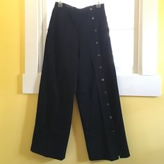 Vintage - Maurice Sasson button down black pant Unique wide leg black pant.  One leg buttons the length of the leg.  The other side has a pocket in the front and back.  100% wool with a lining.  It's cut on an A-line which is complimentary on most figures. Maurice Sasson Pants Wide Leg