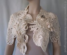 I used 3 different off white, soft acrylic yarns to create this luxury, free form, 3d, crocheted cape. Loaded with details of shape, texture, a