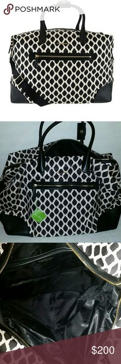 """Vera Bradley Streeterville Travel Duffel Brand new with tag. Color ikat spots. Measures approximately 20""""W x 14""""H x 9""""D with 6-1/2"""" handles and an 8"""" to 21"""" strap drop; weighs approximately 2 lbs, 10 oz Body/lining 100% polyester; trim 100% cowhide leather Vera Bradley Bags Travel Bags"""