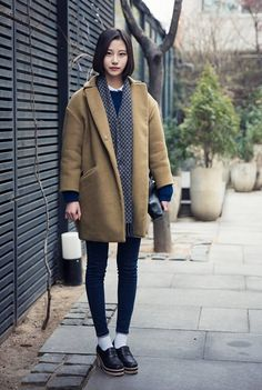 winter 2016 street style in paris. Pattern colors on muffler is great. canada goose fashion show