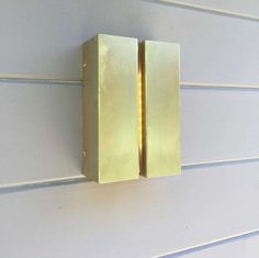 The Breche LED Outdoor Wall Sconce showcases a simple yet sophisticated design with smooth clean lines.