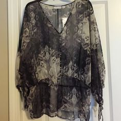 Top Top - NWT. black/purple/white. Button detail down vneck front. Waist gathered. Sleeves have drawstrings at end.100% polyester . See thru. New York & Company Tops Blouses