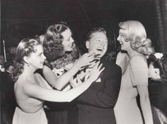 The girls from MGM having some fun with Mickey Rooney… Judy Garland, Eleanor Powell, and Lana Turner