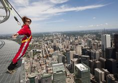 TORONTO - The CN Tower now holds a Guinness World Record for its EdgeWalk attraction — the highest external walk on a building.A certificate of the record was presented to officials Tuesday on the Edg. Toronto Cn Tower, Sky Walk, Stunt Doubles, World Watch, Guinness World, Space Travel, World Records, Ciel, Film Festival