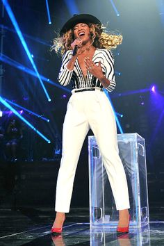 Who run the world? Bey, in her fierce black and white-striped V-neck top and sleek white pants. <3