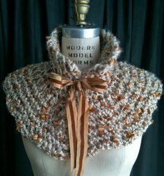 Pot of Gold Hand Knit Women's Capelet / Collar / Scarf / Scarflette with Fancy Ribbon. $40.00, via Etsy.