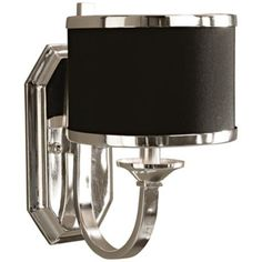 """Uttermost Tuxedo Collection Silver 11 1/2"""" High Sconce(21454)    $129.91    With sleek silver arms and a smart black hardback shade, this handsome wall sconce will make a stylish impact in your home decor. Silver plated finish. Black hardback shade. From the Uttermost Tuxedo Collection of lighting.         •Silver plated finish.   •Black hardback shade.   •From the Uttermost lighting collection.   •Takes one 60 watt bulb (not included).   •11 1/2"""" high.   •7"""" wide.   •Extends 9 1/2"""" from the…"""