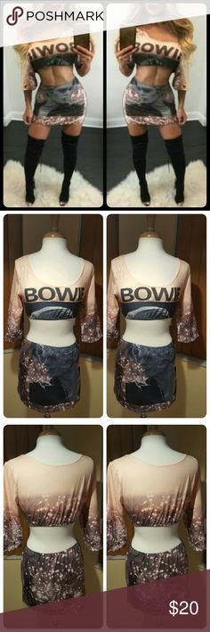 JUST IN. BOWIE PRINTED CROP TOP/SKIRT SET 100% BNWOT. Good condition. Multi colors. Printed bowie set. Runs small and short. On mannequin is size Asian xl which is / us size 10. Has little to no stretch. Have design cuts on top along with silver circle on sleeves. Crop top say bowie. Skirt has bowie face in front along with prints. 65% cotton and 35 %spandex. This is an Asian item which tends to run small. Have various sizes. Price firm. No offers. Bundle for discount. Already listed at the…
