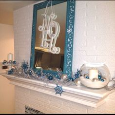 Hand made Noel decoration on a mantel I decorated.   Wrap white with silver yarn around pre cut wooden letters. Hot glue letters in arrangement. Use tulle to hang! Use hot glue to add any accessories. ie: we uses little metal snowflake ornaments. Small jingle bells or  the similar would look okay too!