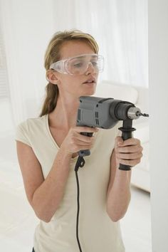 How to Safely Drill in Old Plaster Walls by Jenny Harrington. Hanging items on plaster almost always involves drilling a hole first, since nails may not penetrate the thick surface and they tend to leave cracks if they do make it through the plaster. Drilling a hole in plaster safely prevents cracking around the hole area while minimizing the amount of plaster dust kicked up.