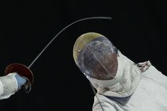 United States' Dagmara Wozniak, left, competes against Venezuela's Alejandra Benitez in the gold medal match of the women's sabre individual fencing competition at the Pan Am Games in Toronto, Ontario, Monday, July 20, 2015. Wozniak won the gold medal. (AP Photo/Felipe Dana)