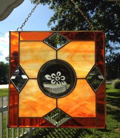 A personal favorite from my Etsy shop https://www.etsy.com/listing/399117125/stained-glass-suncatcher-panel-orange