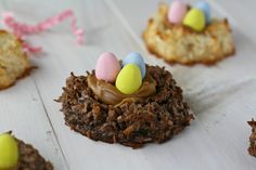 Coconut Macaroon Nests - 2 eggs - sweetened condensed milk - almond extract - cocoa powder - sweetened shredded coconut - chocolate filling - egg candy