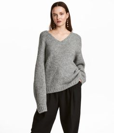 Gray. Chunky-knit sweater with alpaca wool content. V-neck, low dropped shoulders, and longer back section.