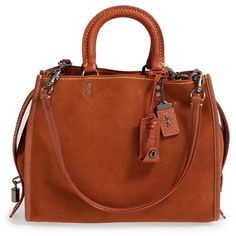 COACH 1941 'Rogue' Leather Satchel ($795) ❤ liked on Polyvore featuring bags, handbags, saddle, brown satchel handbag, brown satchel purse, kiss-lock handbags, satchel handbags and leather handbags
