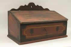 Sold $ 1,000 Rare early to mid -1800s Pennsylvania or Virginia red paint decorated lift top candle box, double-section interior,  black painted borders, black stylized leaf motifs on front inside yellow pinstriping, original paint , 11 H x 16 1/2 W x 9 1/2 D.
