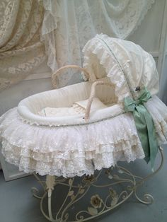 Moses basket with green details.