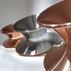 Chair shaped like a spinning top made of spun steel and copper.