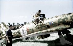 Southern Italy - fighter Pilot Eugenio Salvi enters his cockpit of his Macchi…