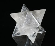 """Quartz """"Merkaba"""" Cut (Brazil). Merkaba crafted from beautiful Brazilian clear quartz. Clear quartz is a stone of amplification, healing, and programmability. It is known for its ability to magnify and store energy, making it programmable with the user's thoughts and intentions. It is also used to amplify the effects of other crystals and minerals. #quartz #crystal #healing #sculpture #merkaba"""
