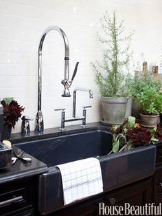 apron sink in inky caviar - kohler faucets and sinks - ann sacks backsplash -  2011 kitchen of the year with tyler florence