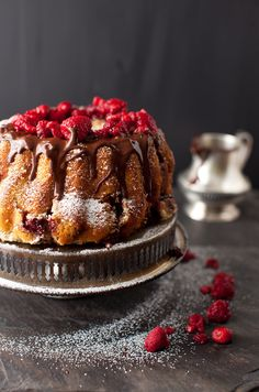 Raspberry Chocolate Cake: moist, dense, coffee cake made of alternating layers of rich sour-cream cake and a filling consisting of raspberries mixed with cocoa sugar. Perfect to serve for breakfast or on Sunday brunch