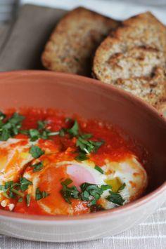 (uova al pomodoro) Eggs baked in tomato sauce.