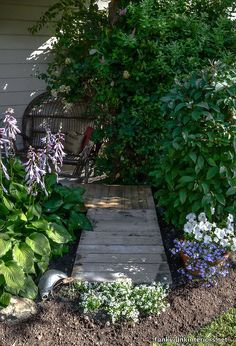 cheating with an instant full pallet garden walkway, concrete masonry, diy, landscape, pallet, repurposing upcycling, A two pallet walkway resides in front of a little sitting area by my front door It s perfect