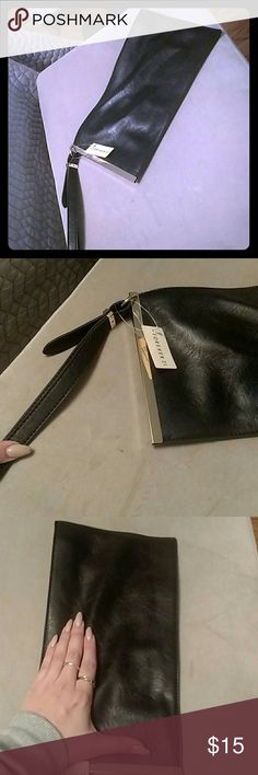 Forever 21 nwt clutch with gold detail and zipper New with tag forever 21 clutch/wristlet with gold detail on one side. Large enough to fit all the things you need to for a night or day out-phone, wallet, keys etc. Comes with hand strap. Never used before. Faux black leather. Forever 21 Bags Clutches & Wristlets