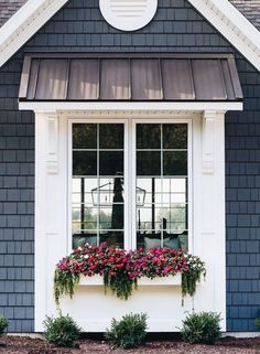 I love this exterior detail around the window... would be a little added heft and classic detail to my plain jane little house...