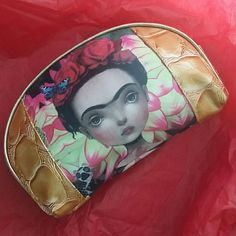 "New Frida Kahlo Cosmetic Bag Mexican Art Flowers Gorgeous cosmetic bag, brand new, no tags, from Mexico, featuring mexican painting artist Frida Kahlo who has been very popular in street fashion lately, you can see her art on shirts and bags specially... Very bright, colorful and beautiful piece!  Measurements 8"" x 2"" x 5.5"" Printed on both front and back. Gold tone on sides, zip closure. Boutique Bags Cosmetic Bags & Cases"