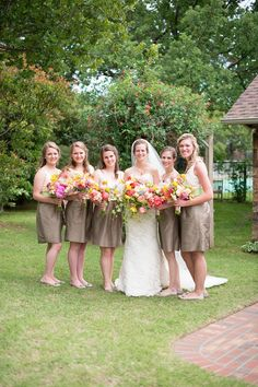 Bridesmaids with bright bouquets from Trochta's! Bride is wearing gown and veil from JJ Kelly Bridal. Photo by Ely Fair Photography. #wedding #bridesmaids #tan #taupe #green