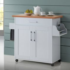 Andover Mills® Kitchen Island can be used as a cabinet space as well as tabletop for small appliances. A great way to save space and reorganize any kitchen, this multipurpose cart is a great addition to any home. The single drawer and cabinet below provide compact kitchen storage for a wide range of items; including small kitchen accessories, utensils, dry goods, as well as plates and baking dishes.