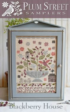 Blackberry House - Plum Street Samplers Design mounted in a Lone Elm Lane sewing cabinet. Cross Stitch Samplers, Cross Stitch Kits, Cross Stitch Designs, Cross Stitching, Cross Stitch Embroidery, Embroidery Patterns, Cross Stitch Patterns, Blackbird Designs, Cross Stitch Finishing
