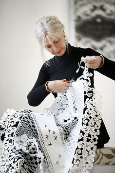 Danish/Norwegian artist Karen Bit Vejle at work with her psaligraphy; the art of making pictures of paper and air, using only a pair of scissors