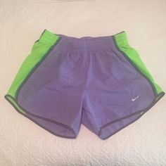Women's dri-fit Nike shorts Purple and green women's Nike shorts size XS. Selling because it no longer fit me. It is clean and in perfect condition. Absolutely no signs of wear! Nike Shorts