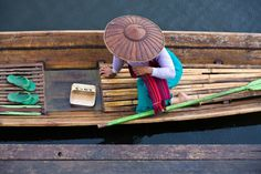 Guide to inle lake.   Woman waiting on her pirogue under rain in Inle Lake, Myanmar. Image by Santiago Urquijo / Flickr / Getty