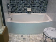Kohler Expanse Tub - Curved apron for more bathing space in a standard size alcove . Like tile work also Hall Bathroom, Upstairs Bathrooms, Bathroom Kids, Ocean Bathroom, Condo Bathroom, Shower Bathroom, Master Shower, Bathroom Small, Kids Bath