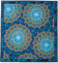 a gorgeous kaleidoscope quilt by Paula Nadelstern