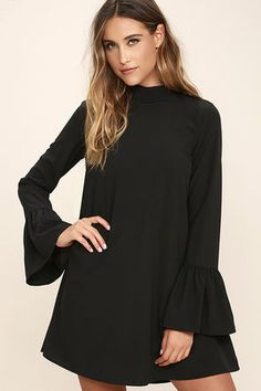 The Mod Squad Black Shift Dress is the perfect addition to your crew of on-trend pieces! Lightweight poly shapes a mock neck and fun, tying open back. Long bell sleeves and a shift silhouette complete the look.