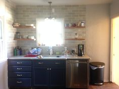 Dark blue kitchen cabinets blue Ann sacks tile Spanish style house opened up wall