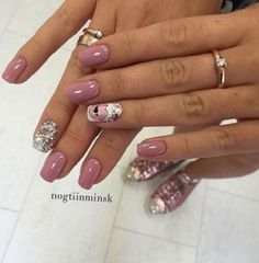 Beautiful rose pink winter nail art design. The nails are a complete contrast to each other. There are plain rose pink nails while the other nails are colorfully painted with pretty patterns and details.