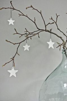 super easy christmas decor: twigs, glass jar, clay stars. love the simplicity.